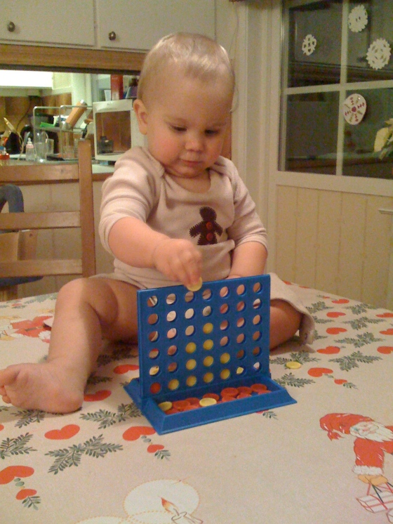 """Alfie in competition with his friend Jack, and """"playing"""" connect 4 on the table"""