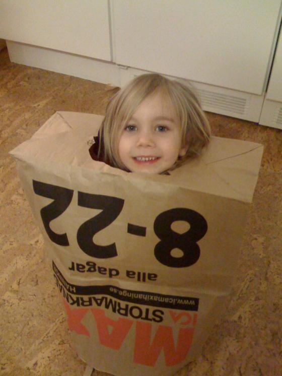 Maya dressed as a bag....