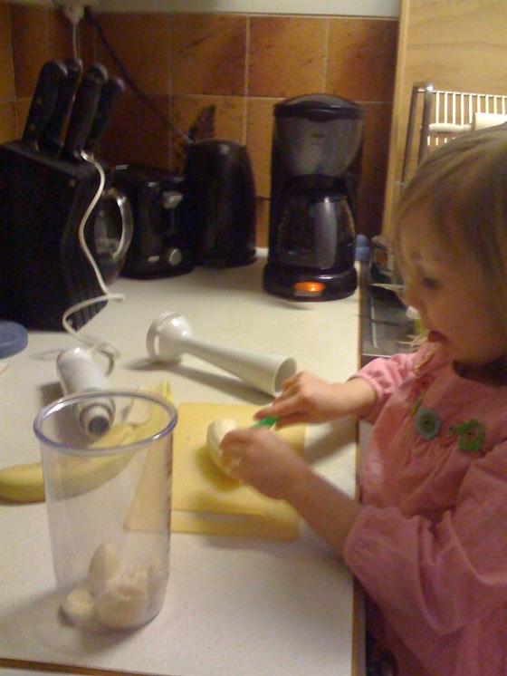 Maya making a banana smoothie