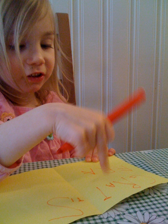 Maya writing a birthday card - just look at those lovely letters!