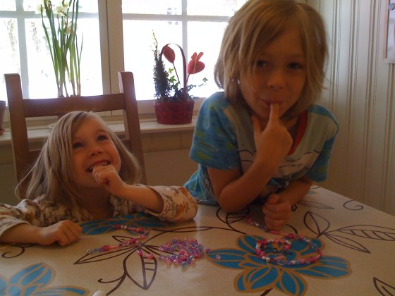 Two cheeky monkeys making necklaces from new beads!