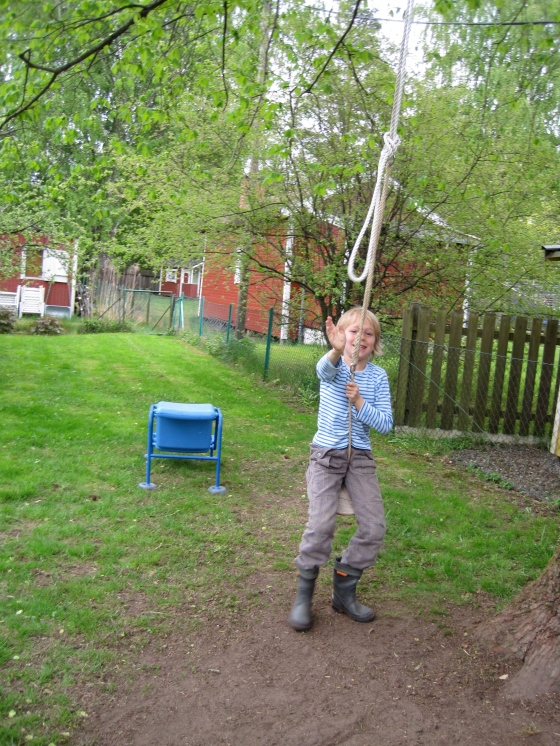 On the swing (presently Leon's favourite garden spot!)