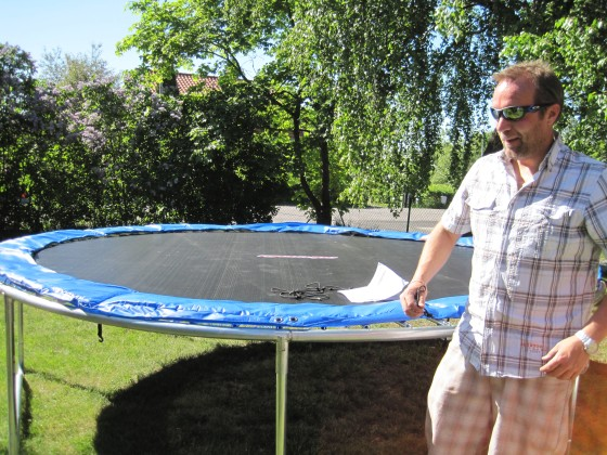 4 pm - a sexy man in shades puts the finishing touches to a trampoline we have just purchased (yes, we had to succumb, in order to stop our children from bombarding all the neighbours trampolines...)!