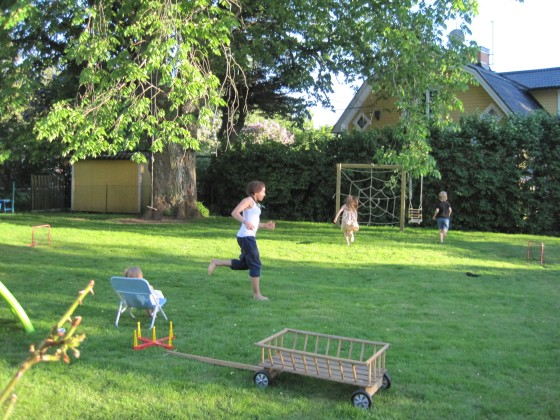 "7 pm - Playing ""brannboll"" (rounders) with the girls from next door (Maya takes it easy in the deckchair acting as referee!)"