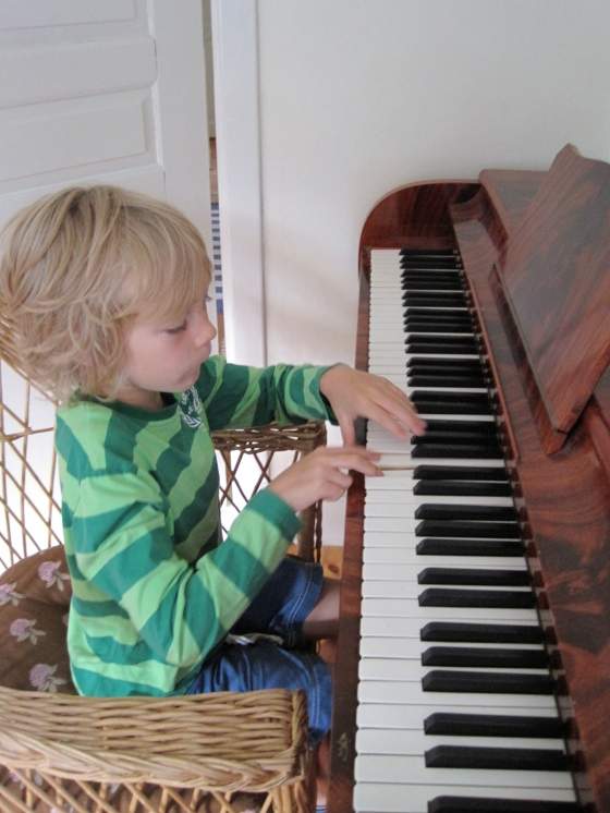 Leon making the most of a REAL piano!