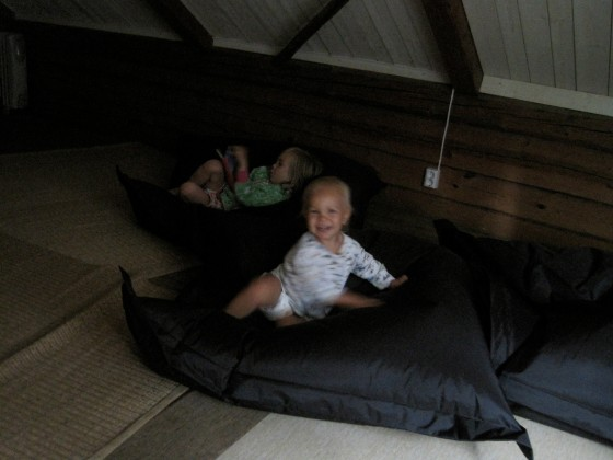"Maya and Alfie enjoying a game of ""jumping onto a beanbag and sliding across a wooden floor at great speed"" (Alfie ended the holiday with no less than two head bruises, a black eye and a split lip...)"
