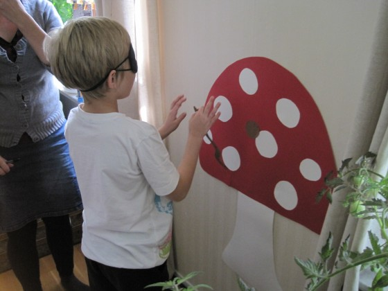 "I made a toadstool from coloured card, then stuck on a small brown circle for the worm's hole. The children then used a brown worm I had also cut out, to try to stick on the ""hole"" while blindfolded. The one who is closest wins."