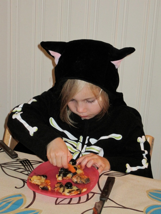 Maya ate hers dressed as cat-skeleton-girl!